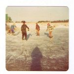 Kids playing hockey on the pond at Grand Tracadie.